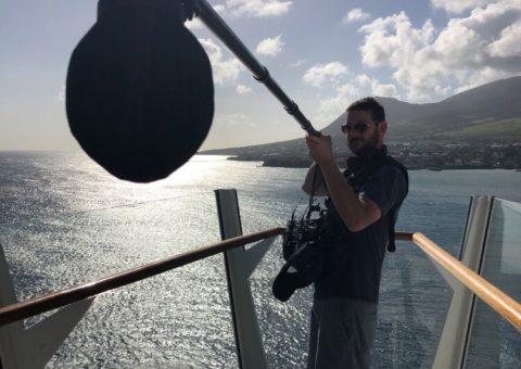 A BBP Film Crew member capturing audio at sea
